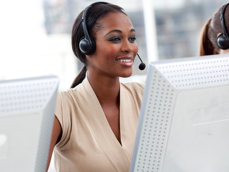 Female customer service agent with headset on in a call center